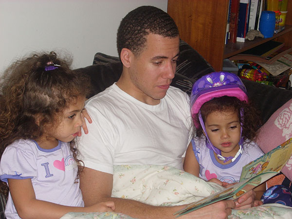 Dad reading to girls